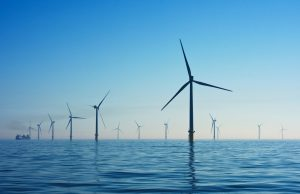an image of a windfarm in the ocean